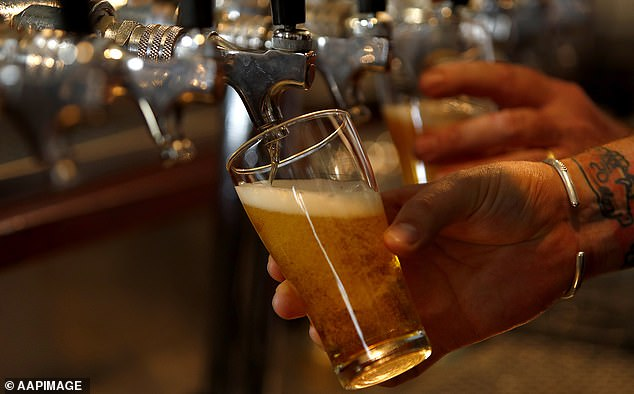 The NHS says no level of drinking is safe, and recommends people in the UK drink no more than 14 units a week, spread over at least three days (file photo)
